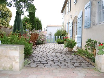 Beautiful townhouse with heated pool & secluded walled garden. Sleeps 2 to 16