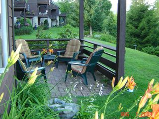 Lake Placid condo photo - Condo Patio- lake front, gardens, fountain