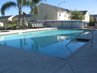 Club Cortile condo photo - Heated pool
