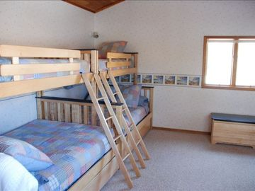 Upstairs bunkroom has 2 single over full size with pull out single trundles.
