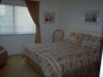 Queen bed in the large second bedroom.