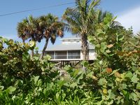 Palm Island Waterfront 4BD/2BA Home with Beautiful Beach views and Private dock!