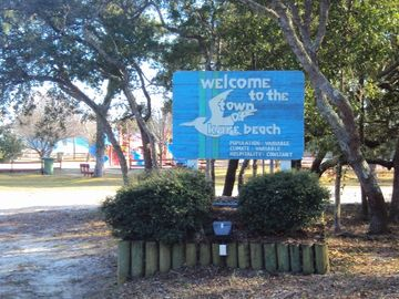 Kure Beach sign on K Avenue. House at G and Fort Fisher Blvd.