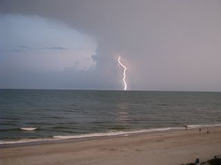 Blue Water Resort condo photo - View of an approaching storm as seen from our balcony.