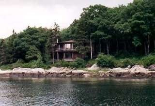 Westport Island cottage photo - Nestled among the trees at water's edge...