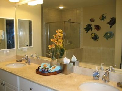 Master bath has separate tub and walk-in shower