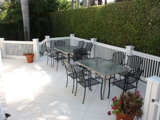 Old Naples house photo - Lower lanai features seating for twelve and access to Weber Genesis gas grill.
