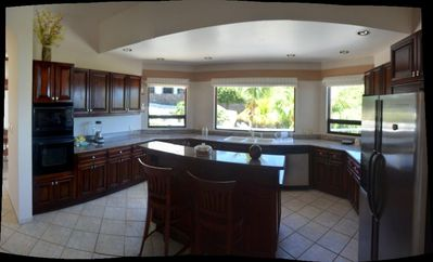 Large, spacious kitchen with Corian countertops & stainless steel appliances