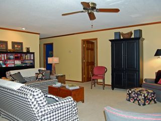 Lake Gaston house photo - Black cabinet houses flat-screen TV, DVD player and stereo