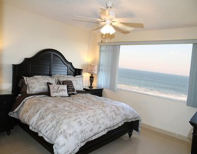 Master Bedroom with an AMAZING ocean view! Has a King bed and a flatscreen TV.