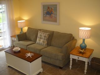 St. Simons Island condo photo - Queen size pull out sleeper sofa with coffee table full of games.