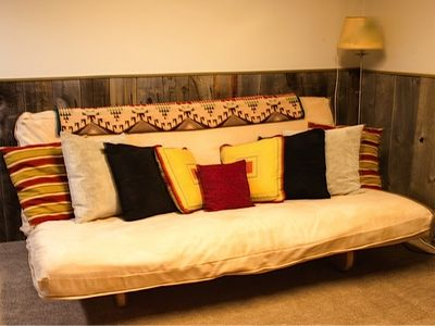 Bozeman house rental - Futon sofa bed with big TV, right outside of third bedroom