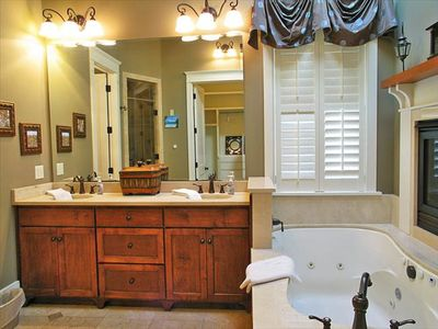 Master bathroom with double sided fireplace, Jacuzzi tub, stand up shower, etc.