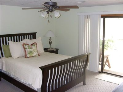 Bedroom with queen bed & view of lake