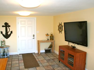 55 inch TV with full cable package and XBOX Kinect with games provided.