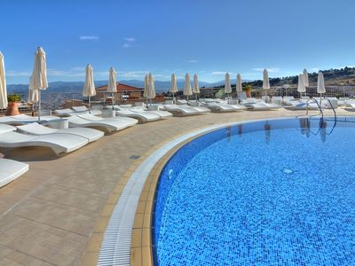 Dhrousha apartment rental - The spectacular swimming pool and sunbathing area at the Latchi Panorama Resort