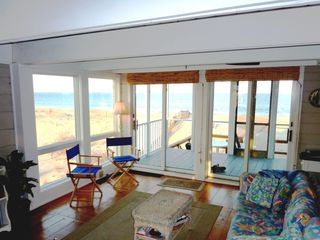 First floor living area. Sliders open to oceanfront screened porch plus a deck