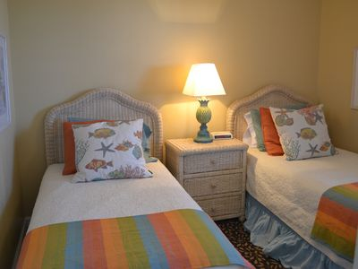 Twin beds in guest bedroom! Love those pillows!