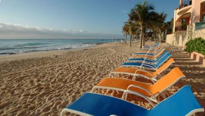 White sandy beach with numerous beachchairs