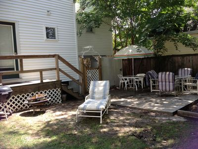 Spacious back yard with gas and charcoal grills, picnic table, 2 round tables