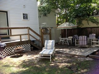 Dewey Beach house photo - Spacious back yard with gas and charcoal grills, picnic table, 2 round tables