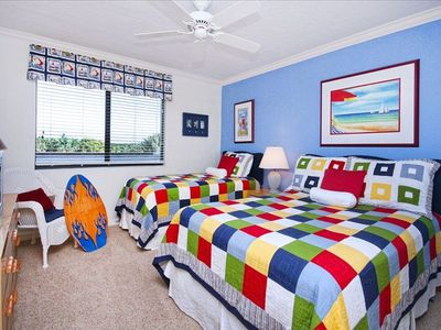 Whimsical guestroom with twin and double beds. Bedrails available for the kids!