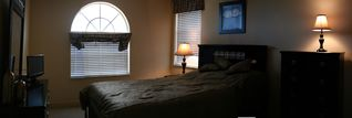 Vacation Homes in Marco Island house photo - Upstairs bedroom with queen bed and TV