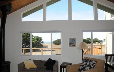 Front windows of the living room facing West with views of the ocean