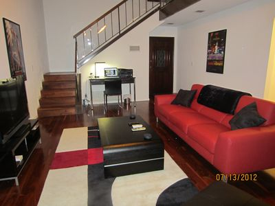 Living room, reverse angle, with staircase behind.