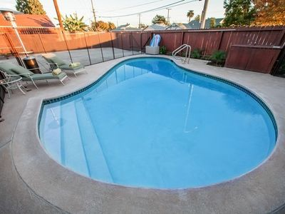Unique Heart Shaped Heated Swimming Pool with Pool Fenc