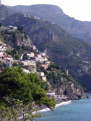 Positano house photo - Positano, with the village of Nocelle on the hillside above.