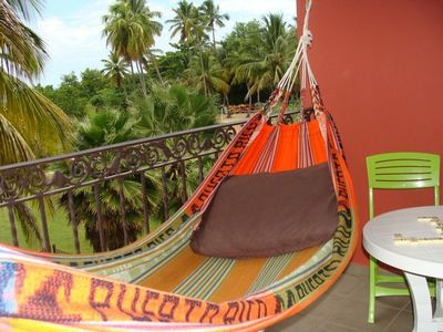 Enjoy the Caribbean breeze from the hammock.