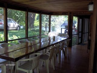 Lake George house photo - Dining Porch, seats 12 at an Adirondack Table