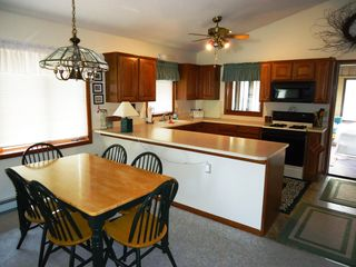 Bellaire / Shanty Creek cottage photo - full kitchen, open to dining and living area