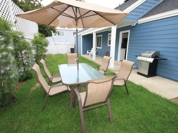 Our backyard is great for entertaining: big table, BBQ, outdoor speakers.