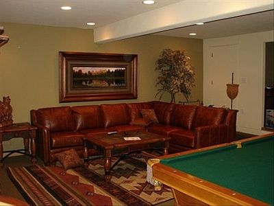 "Relax in the large den with 52"" HD TV & pool table!"
