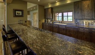 Big Sky house photo - Kitchen with bar seating