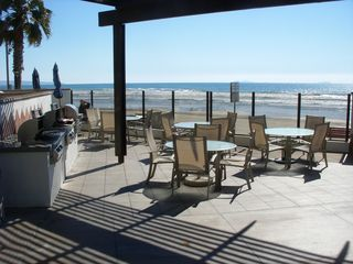 Barbeque grills and patio near pool. - Coronado condo vacation rental photo