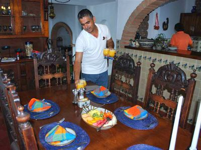 Puerto Vallarta villa rental - Pepe sets out his freshly squeezed orange juice while Mari cooks breakfast.