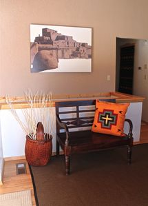 "Entry Hall and original artwork, ""Taos Pueblo"""