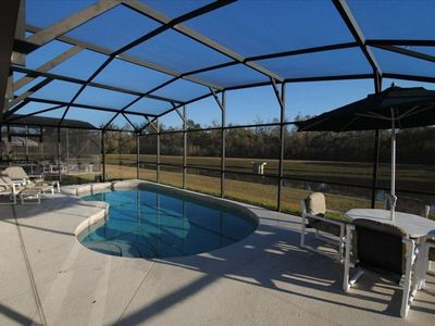 Pool with opt heat, patio table with 6 chairs (2 that recline) with pond view.