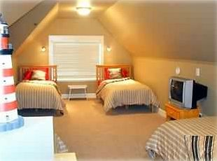 Upper Level: Spacious loft holds 4 twin beds - a full bath is across the hall.