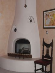 Albuquerque house photo - Gas fireplaces set the stage for evenings of enchantment.