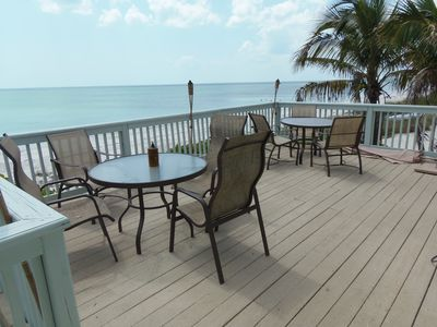 Large top deck overlooks gulf! Umbrella avaiable ! Gas Grill and charcoal grill.