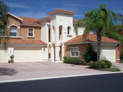 Gated community Coach home with 2 car garage and lanai overlooking water