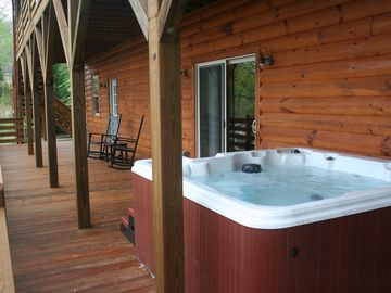 6 person hot tub on lower deck with mountain view