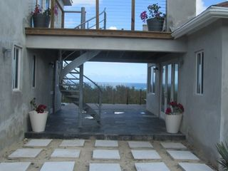 Governor's Harbour villa photo - Exterior pic with spiral staircase and slate breezeway between 2 buildings