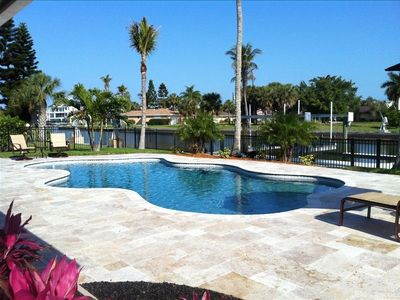 18'x34' Heated Pool, Travertine Deck, LED Lighting, Dock, Tropical Landscaping