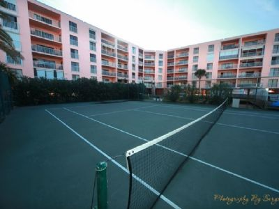 Tennis court and view of condominium