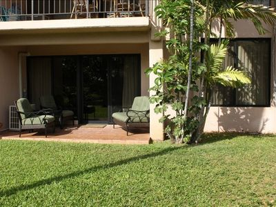 Enjoy a comfortable view of lush gardens from the walk-out lanai.